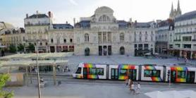 The Place de Ralliement in Angers.  Ancient buildings, Restaurants, theatre and a modern Tram system.  A snapshot of Angers.